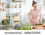 woman preparing healthy meal in ... | Shutterstock . vector #688633084