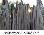 old wooden fence and a ray of... | Shutterstock . vector #688644274