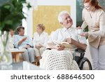 smiling elder man on wheelchair ... | Shutterstock . vector #688646500