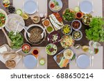 wooden table set with organic... | Shutterstock . vector #688650214