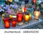 lighting candles on the grave.... | Shutterstock . vector #688650250