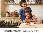 little girl cooking with her... | Shutterstock . vector #688672744