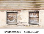 Facade Of An Old House With Tw...