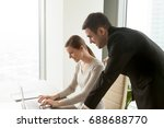 smiling young intern working on ... | Shutterstock . vector #688688770