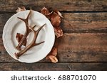 plate with deer antlers and dry ... | Shutterstock . vector #688701070