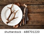 deer antlers on plate with... | Shutterstock . vector #688701220