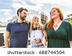 group of friends laughing and... | Shutterstock . vector #688744504