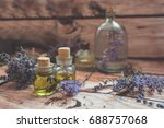 lavender oil with fresh flowers ... | Shutterstock . vector #688757068