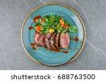 juicy skirt steak in addition... | Shutterstock . vector #688763500