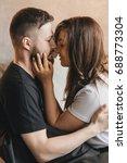 loving couple hug each other on ... | Shutterstock . vector #688773304