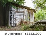 Old Gray Wooden Shed Near Tall...