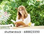 shot of a cheerful mature woman ... | Shutterstock . vector #688823350