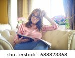 shot of a relaxed middle aged... | Shutterstock . vector #688823368