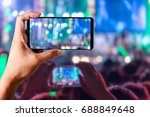 Small photo of People hands use smart phones record video concert music festival live streaming video on internet to social media comment chat to Friend