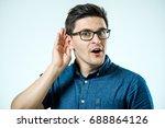 head shot of man  hand to ear... | Shutterstock . vector #688864126