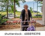 elderly women with a walker at... | Shutterstock . vector #688898398