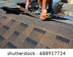 repairing of roof by cutting... | Shutterstock . vector #688917724