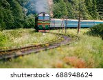 locomotive with wagons riding... | Shutterstock . vector #688948624