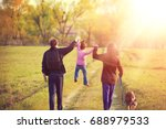 happy family with dog walking... | Shutterstock . vector #688979533