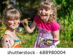 little happy sisters play with... | Shutterstock . vector #688980004