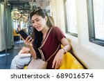 asian woman passenger with... | Shutterstock . vector #689016574