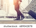 businessman drag luggage in...   Shutterstock . vector #689042878