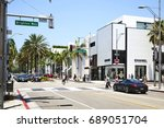 Small photo of Los Angeles USA - July 1, 2017: Rodeo drive in Beverly Hills with people and stores. Rodeo Drive is an affluent shopping district known for designer label and haute couture fashion.