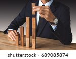 businessman hand arranging... | Shutterstock . vector #689085874
