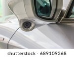 Small photo of Modern car side rear mirror with blind spot camera