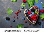mix of summer berries in heart... | Shutterstock . vector #689119624