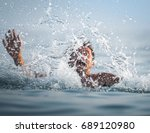 man panics and drowns in the sea | Shutterstock . vector #689120980