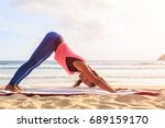 asian woman playing yoga and... | Shutterstock . vector #689159170