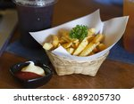 tasty french fries on wooden...   Shutterstock . vector #689205730