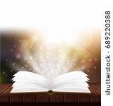 vector open magic book. magic...   Shutterstock .eps vector #689220388
