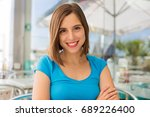 young woman in a restaurant... | Shutterstock . vector #689226400