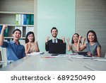 happy successful multiracial... | Shutterstock . vector #689250490
