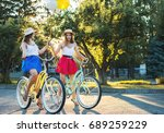 two stylish young female... | Shutterstock . vector #689259229