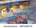 beautifully decorated cakes on... | Shutterstock . vector #689268076