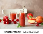 delicious juice in bottle and... | Shutterstock . vector #689269360