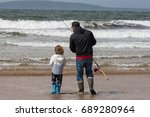 father and son fishing on the... | Shutterstock . vector #689280964