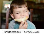 boy eating bread with cream... | Shutterstock . vector #689282638