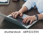 woman's hands typing on... | Shutterstock . vector #689321554