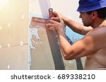fifty years old manual worker... | Shutterstock . vector #689338210