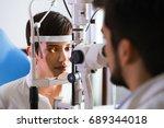 optometrist checking patient... | Shutterstock . vector #689344018