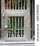 Small photo of Door of empty wooden bird cage in retro style show concepts of entrance, taking chance, security, conceptual and imagination block, and trap