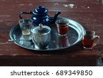 metal tray with blue tea kettle ... | Shutterstock . vector #689349850