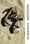 elegant sandals laying on a... | Shutterstock . vector #689352040