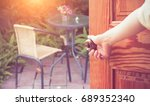 women hand open door knob or... | Shutterstock . vector #689352340