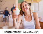 young woman in a resort with... | Shutterstock . vector #689357854