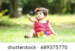 cute baby girl sitting on the... | Shutterstock . vector #689375770